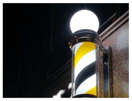 Poste de barbero con luz