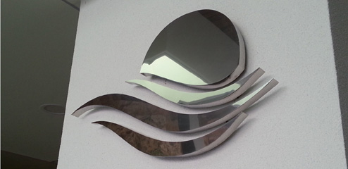 Letra corpórea de acero ciego con iluminación indirecta
